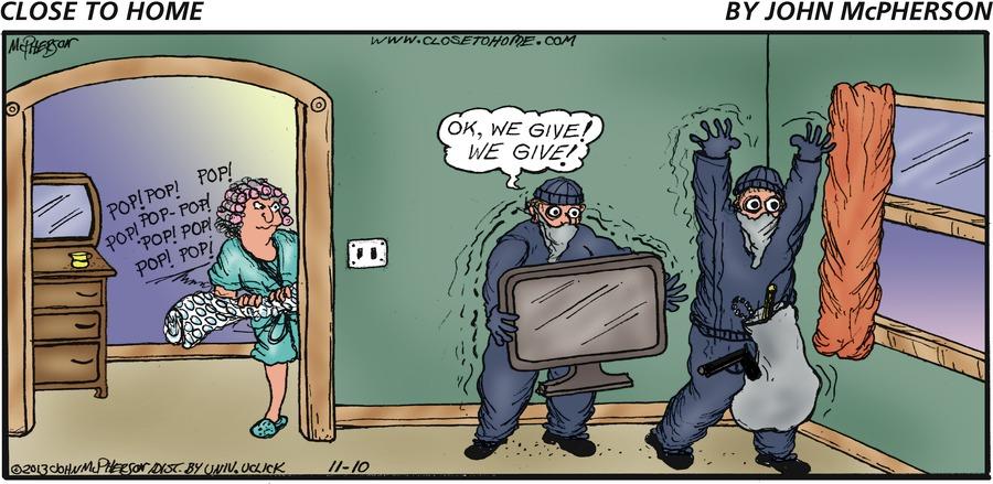 Burglar on the left: Ok, we give! We give!