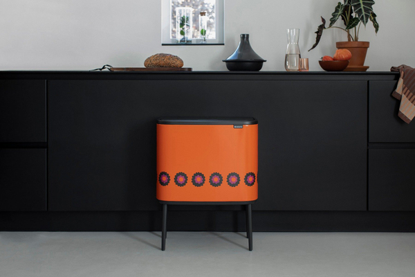 """Who says a trash can can't rock style? """"Live Bold. Live Retro"""" is the tagline for Brabantia's footed touch bin, which sports 1969 flower print bloom decoration. The original flowers were hand cut from paper, giving the design an artisanal vibe. There are (up to three) removable inner buckets for waste separation. Brabantia PerfectFit bags are available to snugly set in without overlap."""