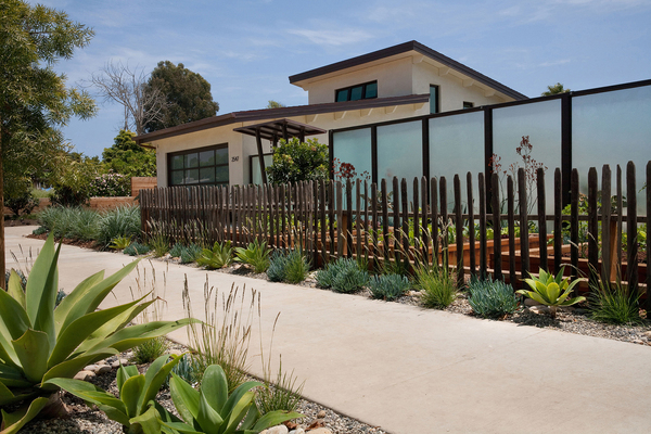 "Raised vegetable beds in front of this Southern California home are framed within a picket fence made of recycled wood. ""This is a good-neighbor garden,"" Grace says. The rustic fence helps make the contemporary home more approachable. It's all architecturally interesting, sustainable and fun."