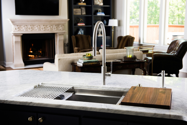 The sink is the newest implement making a splash in the kitchen. The kitchen sink is evolving into a workstation with more than just washing options, and can feature a custom-made walnut cutting board and drying rack.
