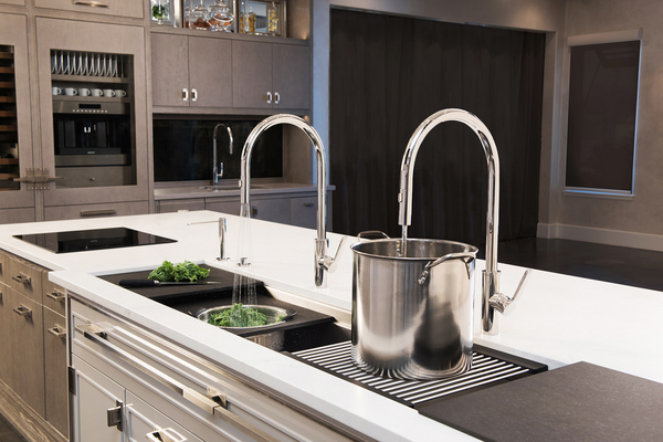 With a long kitchen sink workstation installed on the island, multiple people can perform meal multitasking. With a cooktop installed next to the sink workstation, a cook can chop vegetables and saute in one fell sizzle.