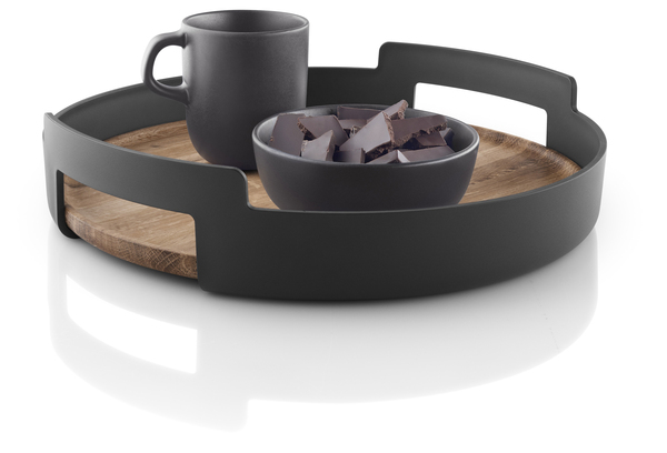 Matte black is having a moment on appliances, dinnerware and here in a classic, modern serving tray in combination with teak, from Eva Solo.