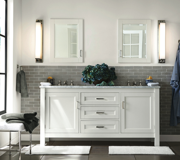 "A light, bright and white color palette is the backdrop for refreshing nature themes, with a beachy blue accent in a home's ""water closet."" Pottery Barn's Maxfield Double Sink Console retails for $3,299."
