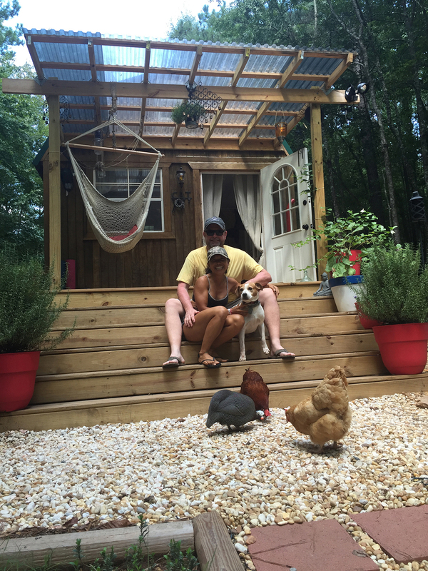 John Kernohan, founder and chairperson of the United Tiny House Association, with his wife, Fin, have enjoyed their off-grid 304-square-foot tiny house, known as Beloved Cabin, since 2011. They homestead in the woods of Putnam County, Georgia, and have embraced solar energy, rainwater collection, raising chickens and growing their own food.