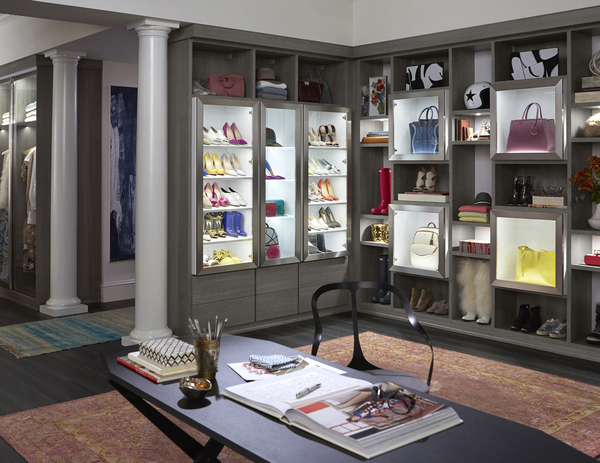 """The closet en suite is a highly personalized space. As more adults have """"homework,"""" setting up a desk in the master closet allows homeowners to both dress up and check up on work before starting the day."""
