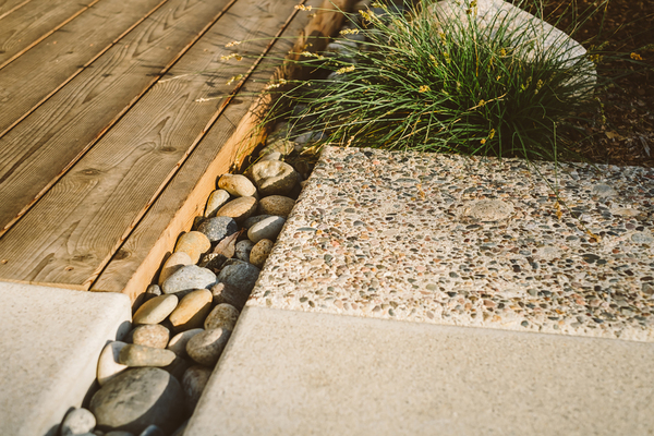 Mixing materials can look haphazard in a garden, but when the materials are chosen carefully and with attention to detail, they elevate an ordinary garden to an extraordinary experience. This intersection in a California garden designed by Ryan Prange of Falling Waters Landscape shows the hand of a pro at work.