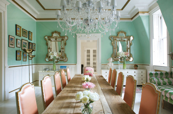 Bikoff worked a palette of peach and jade green in the dining room she designed for her mother at the Dakota. Modern mismatched consoles, Pierre Cardin on the left, Tommy Parzinger on the right, are paired with vintage Murano mirrors. And a 14-foot-long vintage French pine trestle table contrasts with French style chairs from Julia Gray clad in silk satin Scalamandre. The fun apple green print sofa is from Anthropologie.