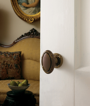 "A doorknob can, in turn, be both functional and ornamental, like ""jewelry"" on the blank canvas of a door. Baldwin Hardware achieves this vintage doorknob look by hand-distressing the brass finish, which retails for $165."