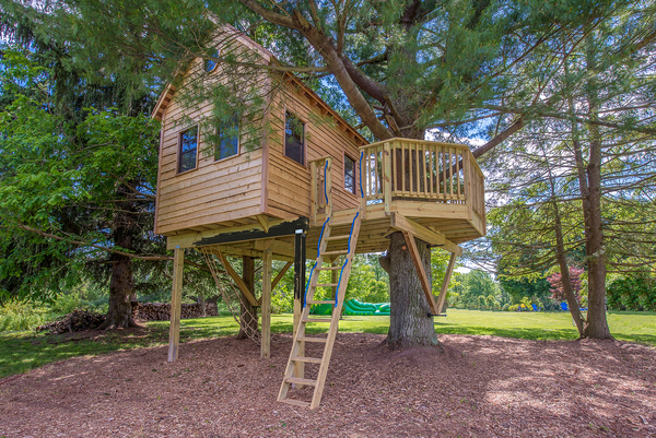 This cedar-clad treehouse was built in Chester County, Pennsylvania, and features a 10-by-12-foot house with an even larger deck built around a tree. Special features include a trap door, kid-sized crawl-through doors and a cargo climbing ladder.