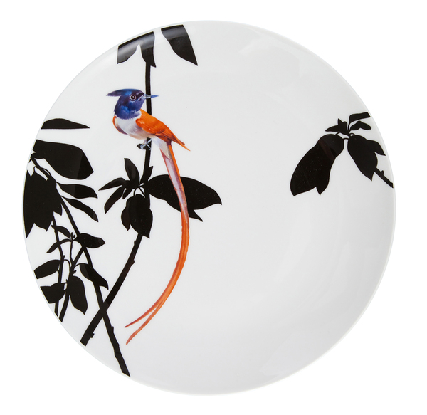 Birds perched on flowery branches, strikingly silhouetted on a white plate resemble paper-cut pieces in Meissen's Flying Jewels pattern, introduced at Ambiente at Messe Frankfurt. The birds are hand-painted.