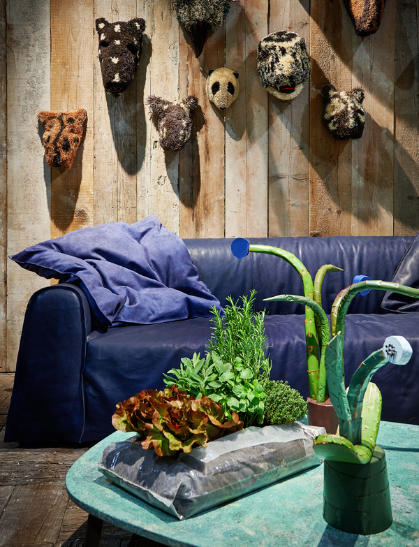 A fashionable slipcover in indigo is unexpectedly kid-glove soft, as it's actually sewn with outdoor leather. The Taipei sofa is designed by Paola Navone for Baxter; the oversized pillow is in an outdoor suede.