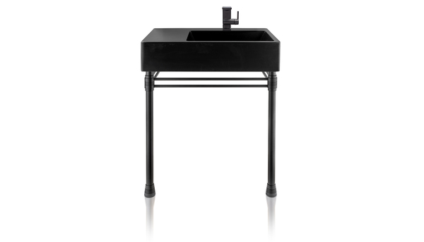 An asymmetrical sink with an industrial look is a striking silhouette in matte black. The Escondido Vanity from Thompson Traders has an off-center design that offers additional counter space. Its sleek shape is elegance and grace in harmony. This is a new matte black finish from Thompson Traders, created by expert coppersmiths in Santa Clara del Cobre, Mexico. It complements popular design trends today.
