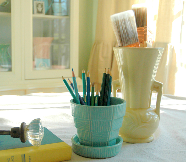 Finding a place for everything -- so everything can be in its place -- is an important component to keeping a mom cave clean. Use containers that are pretty and inspire creativity.