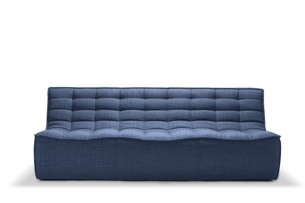 The tufted N701 three-seater armless sofa with a strong horizontal pattern from Ethnicraft stands out in a shade of Classic Blue, the Pantone Color of the Year. The sofa, designed by Jacques Deneef, is available in different sizes, allowing bunching together to create your own unique setting.