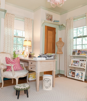 Kristie Barnett, a Nashville-based interior designer and blogger known as The Decorologist, says the colors used in a mom cave are very personal, and don't have to match the decor of the rest of the home. Barnett's mom cave has painted white walls with pink and green accent colors and furniture that can be easily moved around to keep the space fresh.