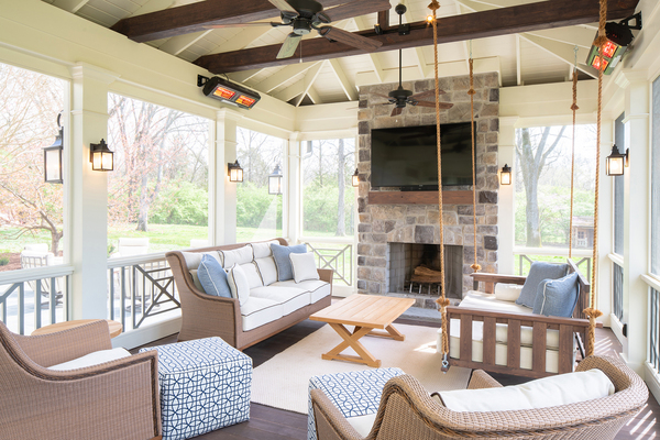 A homeowner can shoot the breeze or just catch one on this airy back porch. The Porch Co.'s Craftsman pine bed swing ($1,650), can double as seating with enough pillows in place.