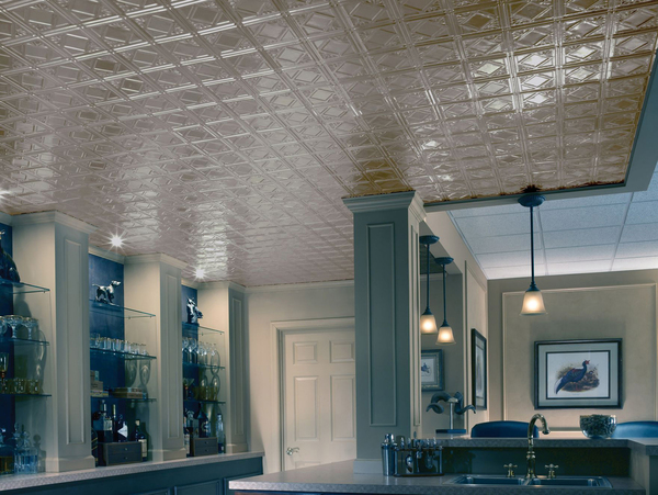 Cool, chic, chrome-plated Armstrong's Metallaire drop panel ceiling reflects a sophisticated aesthetic in this basement's bar.