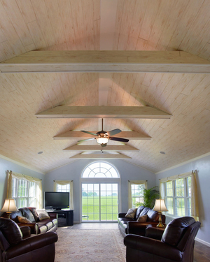 Armstrong's engineered Woodhaven planks create natural interest in the ceiling. Made with tongue-and-groove construction, these planks can cost around $3.30 per square foot.