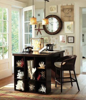 A beach aesthetic doesn't have to be watered down into an all-or-nothing endeavor in your home. You can start small by creating a reeflike refuge in your home office. Pictured here is Pottery Barn's Bedford Project Table ($1,199) with coral accents.