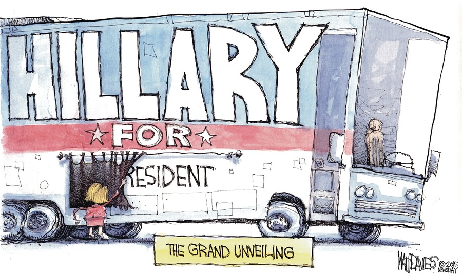 "The Grand Unveiling. Hillary Clinton pulls back a curtain on the side of a large RV. ""Hillary For"" were already visible. She's only unveiling the word ""President."""