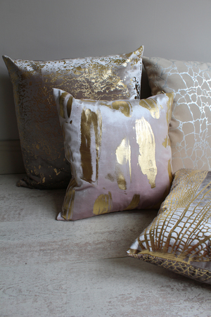 Designer Aoife Mullane brings sparkle to her textiles with foiling on fabric. Her inspiration is sea glass and pebbles on the beach, and she draws the design, then prints them on fabric. The glamorous metallic touches in bronze, copper and silver remind her of those pebbles that sometimes sparkle with quartz. Mullane was an exhibitor at Showcase Ireland 2018 in Dublin, where 450 talented makers and designers debuted home products, fashion, jewelry, accessories and giftware.