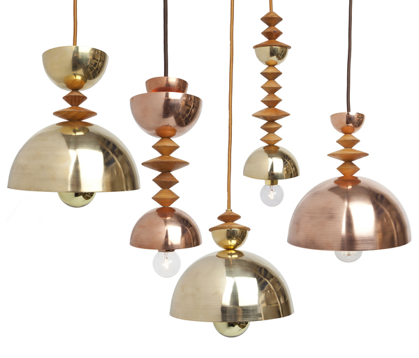 """New York designer Michele Varian is drawn to natural materials, so she says that unlike other lighting designers, all the metal components are solid (not plated or finished) brass, copper or steel. The sculptural Mala """"bead"""" pendants were inspired by Romanian artist Constantin Brancusi and modern primitive design elements, created with simple geometric shapes and solid spun metal shades. The unfinished metal will gently patina with time."""