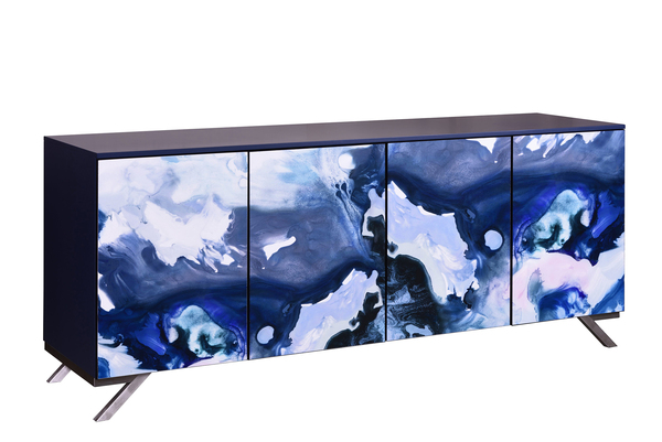 The Lake Shore Watercolor Console from John Strauss Furniture is a piece of art -- a watercolor by Tracy Hiner from Black Crow Studio splashes across the doors. The art was digitally printed, then applied like a veneer to the door panels. Then Strauss put on an acrylic coating in a low sheen for protection. The 84-inch-long, 20-inch-wide, 36-inch-tall case is lacquered with a durable paint in a satin sheen navy. Stainless steel legs in the shape of the numeral 7 are part of a frame that wraps around the back. Touch latch doors open to adjustable shelves.
