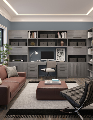 """A traditional modern office can serve different functions with an efficient design. Easy-to-open drawers and cabinets organize supplies, while cubbies and bookshelves provide more storage vertically in this Paxton Office system, featured in the popular """"ash"""" color."""