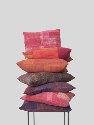 Pillows designed by New York-based artist Sigi Ahl are sewn with felt-crafted fabric made from recycled clothing by fashion designer Eileen Fisher. Fisher is hoping to encourage others in the industry to do the same, working toward zero waste. To date, more than 1 million pieces of clothing have been returned.
