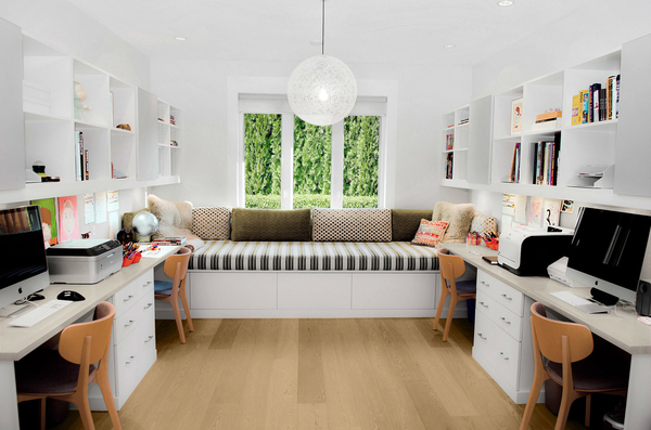 """This versatile space works for the whole family, with designated stations for both adult and children's """"homework."""" Customized cubbies overhead provide places to store individual items, with drawers that work for a home office, as seen in a classic white finish."""