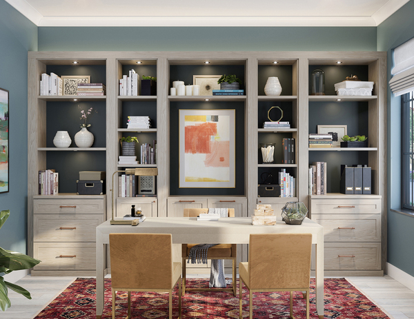 This executive setup in a natural finish mixes both business and pleasure. Closed storage and file drawers organize and keep work out of sight, with cubbies that have accent lights, which showcase plants and personal effects to enliven the space.