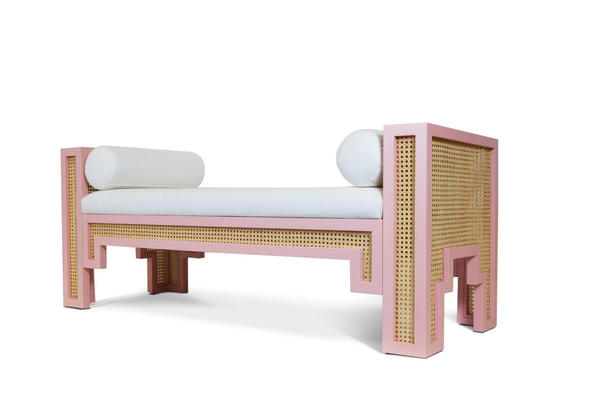 Maggie Cruz draws a little from her Cuban heritage as well as the flavor of her current home base of Miami for the striking Art Deco styling of the Alexandra Cane Bench. It's shown in a coral dust finish with white-washed cane and upholstered in optic white linen.
