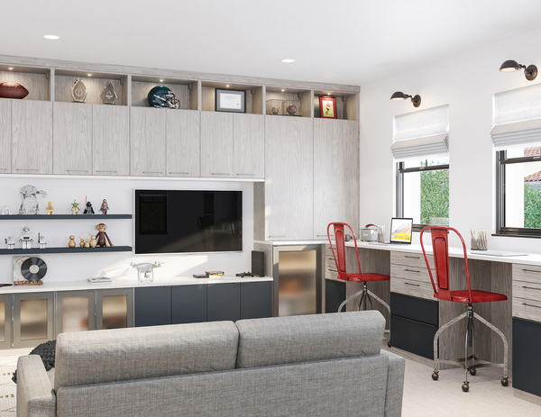 This casual home office is a smart and stylish setup that can be used for work and limited play. This well-lit office with a two-person workstation features whitewashed countertops and gray gradients of cabinetry for storage.