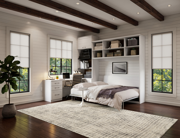 The secret to living and working in the same space is to keep the design simple. A bedroom/home office can feature a fold-down bed, which is hinged at one end to store vertically against the wall inside framed cabinetry.