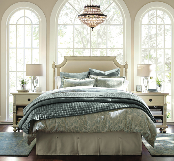Bedding in soothing blue tones becomes a quiet respite when coupled with an all-white headboard and bedroom furniture, whether it's purchased new or is a repurposed and repainted flea market find. Pictured here is the Sofia Headboard, which starts at $999.
