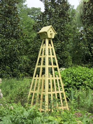 Obelisks are classic structures, but there are no rules that say you can't add your own embellishment. This gardener topped her obelisk with a birdhouse.