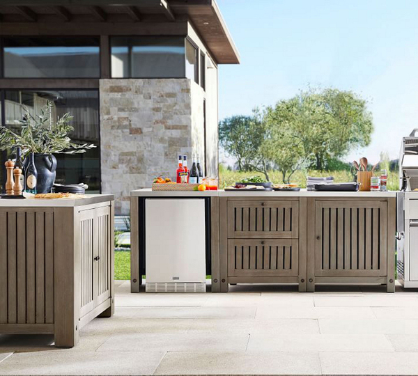 Planning an outdoor kitchen? The three-piece Abbott modular system from Pottery Barn includes a double-door cabinet, refrigerator cabinet and two-drawer plus single-door cabinet with double stainless steel top. It's crafted from solid acacia wood.