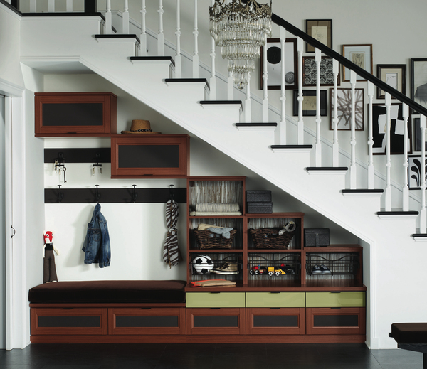 If you're picking up a trail of dirt and clutter, a makeshift mudroom can be organized to utilize the unused space beneath a staircase. There's no mud slinging with shelving, cubbies, hooks and containers built to catch all catchalls.
