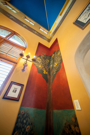 """A music room really sings with inspiration from the Palazzo Davanzati in Florence, Italy, with trompe-l'oeil depictions of lemon trees in each corner. French for """"deceive the eye,"""" trompe-l'oeil is a painting technique that seeks to create realistic imagery."""