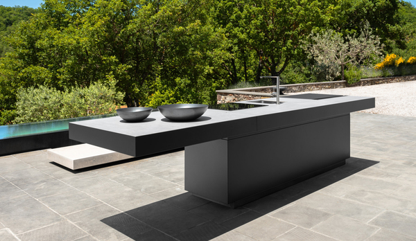 In Europe, fully integrated outdoor kitchens like Tikal from Ethimo feature modules that house sink, barbecue, hobs and optional features, such as mini bars, wine preservers and ice makers. This one combines different metals with stainless steel and a porcelain top with a concrete look.