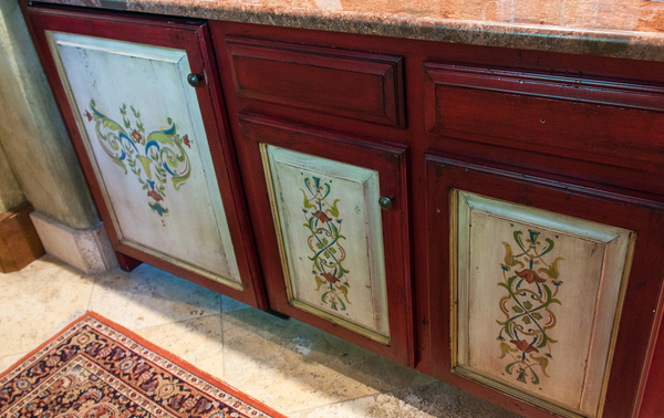 New breakfast kitchen cabinets were painted to look old by Jennifer Bertrand and husband, Chris.
