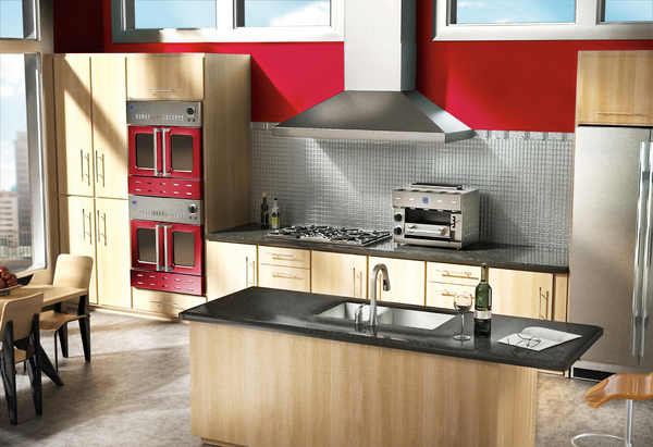 Colored cooking accoutrements -- such as these double wall ovens -- are red-hot in today's kitchens.