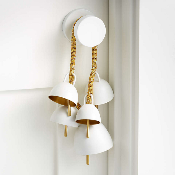 So simple, so pristine. Plus, the sound of jingling bells. This bell swag has a white exterior and gleaming gold interior, and the quintet of stainless steel bells in various sizes are strung along sturdy gold rope. Looped around a bedroom doorknob, the 8.5-inch-wide, 4.5- inch-diameter swag lends a low-key festive touch -- as well as the delightful sound of bells to brighten your holiday mood.