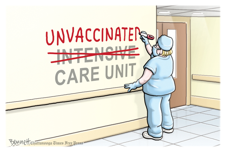 Nurse in hospital corridor changing sign from