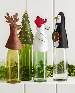 Charming felt wine bottle toppers are an exclusive Garnet Hill design by Katharine and Susan Hable of Hable Construction. Each set of four, handcrafted by skilled artisans, includes a Christmas tree, reindeer, polar bear and penguin.