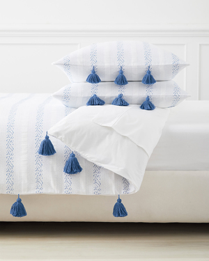 Sweet dreams are made of this: A crisp, simple collection from Serena and Lily is elegantly casual. The French blue-and-white color scheme, subtle embroidered stripes, along with vivid tassels, are evocative of sleeping quarters in a beautiful whitewashed villa by the Mediterranean Sea.