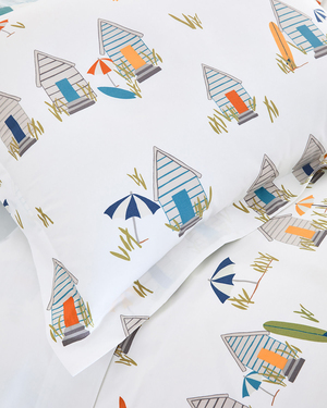 Vibrant beach shacks, sun umbrellas and surfboards evoke a sunny day at the beach with this Cabana bedding from Hable Construction for Garnet Hill. The whimsical designs in bright hues are printed on a brilliant white ground in 200-thread-count cotton percale.