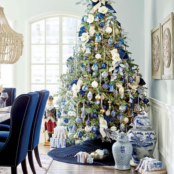 Blue and white is one favorite combination for holiday decor. The Blue Delft collection from Frontgate translates the look from porcelain to mouth-blown glass, plus floral designs sprinkled with gold. The 40-piece collection sold out quickly, but you can curate your own by following their lead, or choose another one of the palettes available.