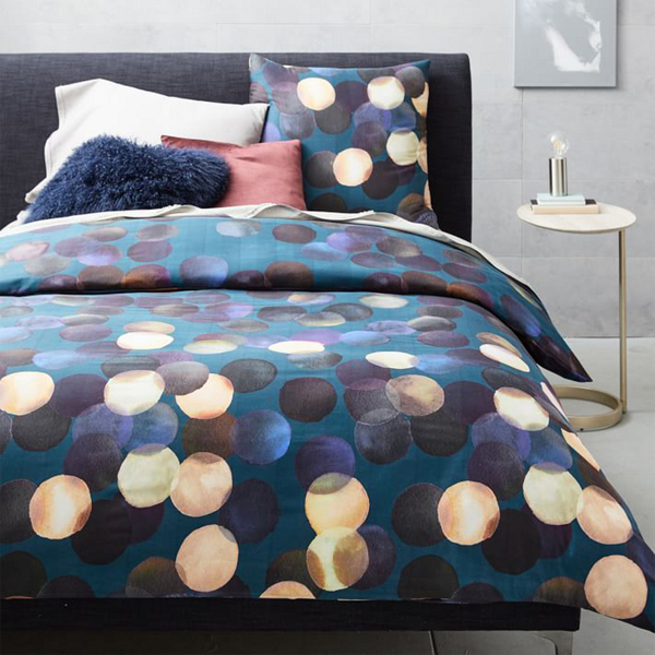 Like modern art on the bed: The Watercolor Dots duvet cover from West Elm playfully adds an abstract layer of color with a painterly motif. It's printed on 400-thread-count organic cotton.