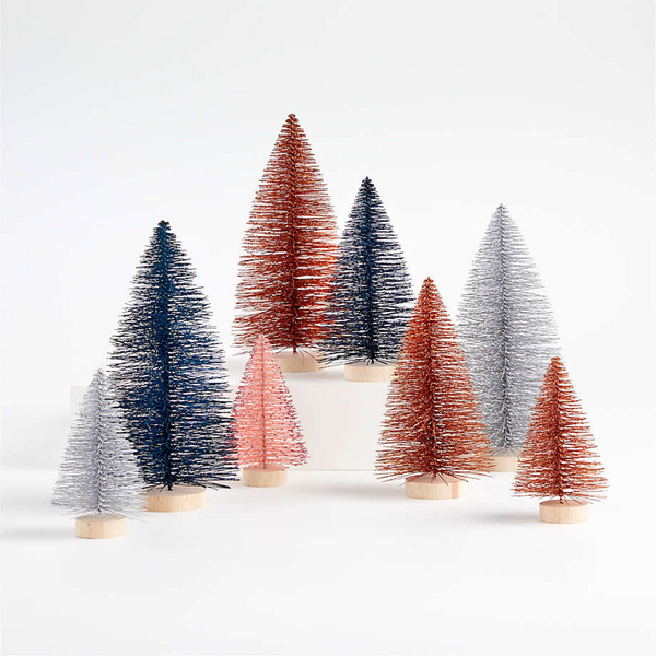 Crate and Barrel's retro bottle brush trees come in a set of eight, in 5-, 7- and 9-inch heights. The style, popular in the 1940s and 1950s, has enjoyed a new wave of popularity in recent years. These are crafted from sisal fiber sprayed with festive glitter and perched on wood stands. Included are two blue, one pink, two silver and three orange, all of which sparkle in the light of candles and string lights. As stand-alone pieces on a mantel, they are a great look for modern decor.
